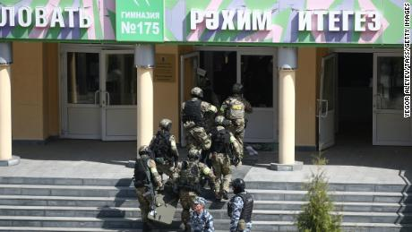 At least 9 killed in Russian school after gunmen open fire, state media report